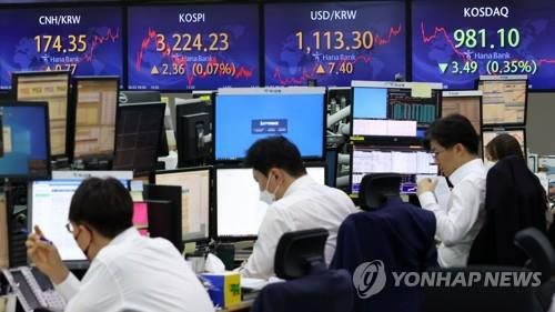 Electronic signboards at a Hana Bank dealing room in Seoul show the benchmark Korea Composite Stock Price Index (KOSPI) closed at 3,224.23 on June 2, 2021, up 2.36 points or 0.07 percent from the previous session's close. (Yonhap)