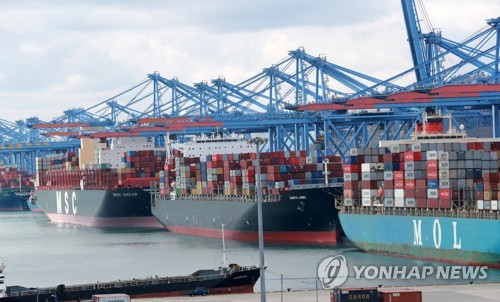 This file photo, taken March 2, 2021, shows ships carrying containers docking at a port in South Korea's southeastern city of Busan. (Yonhap)