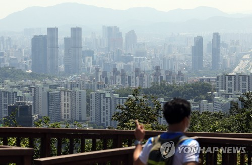 This photo taken May 30, 2021, from Mount Nam in downtown Seoul shows apartment and office buildings in the capital city. (Yonhap)